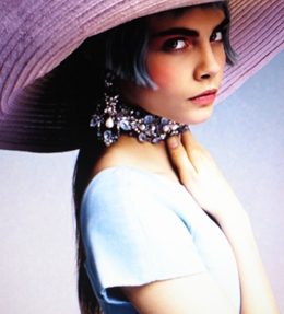 Model Cara Delevigne early in her modeling career. Like the jewelry.