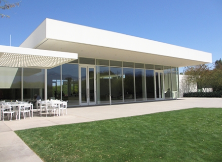 View of the Visitor's Center at Sunnylands from the garden side. Cantilevered roof design.