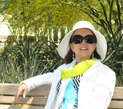 Jasmin on a bench at the gardens at Sunnylands.