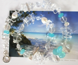 Aqua blue ocean waters of Antigua, an inspiration for this necklace with aqua Chalcedony.