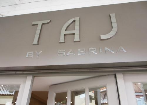 Taj store sign.jpg