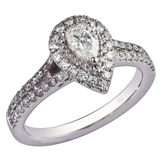 Pear shape diamond and a halo of shared prong set round diamonds.