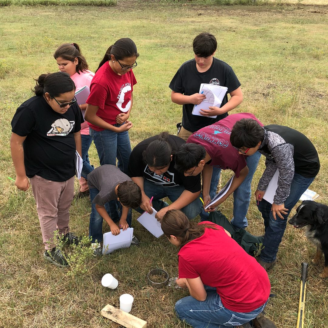 first annual stem camp participants performing a soil compaction test