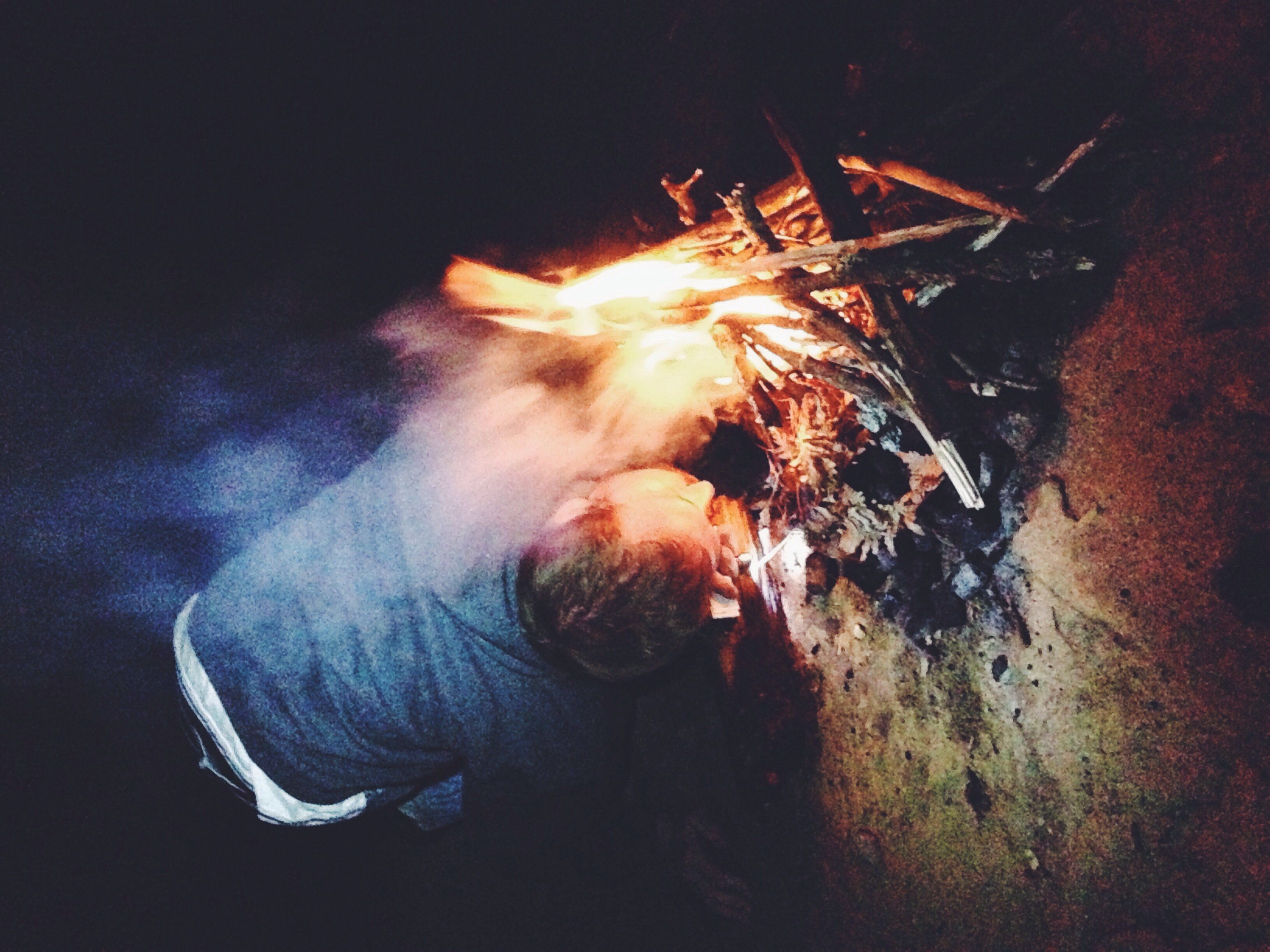 William preparing the fire.