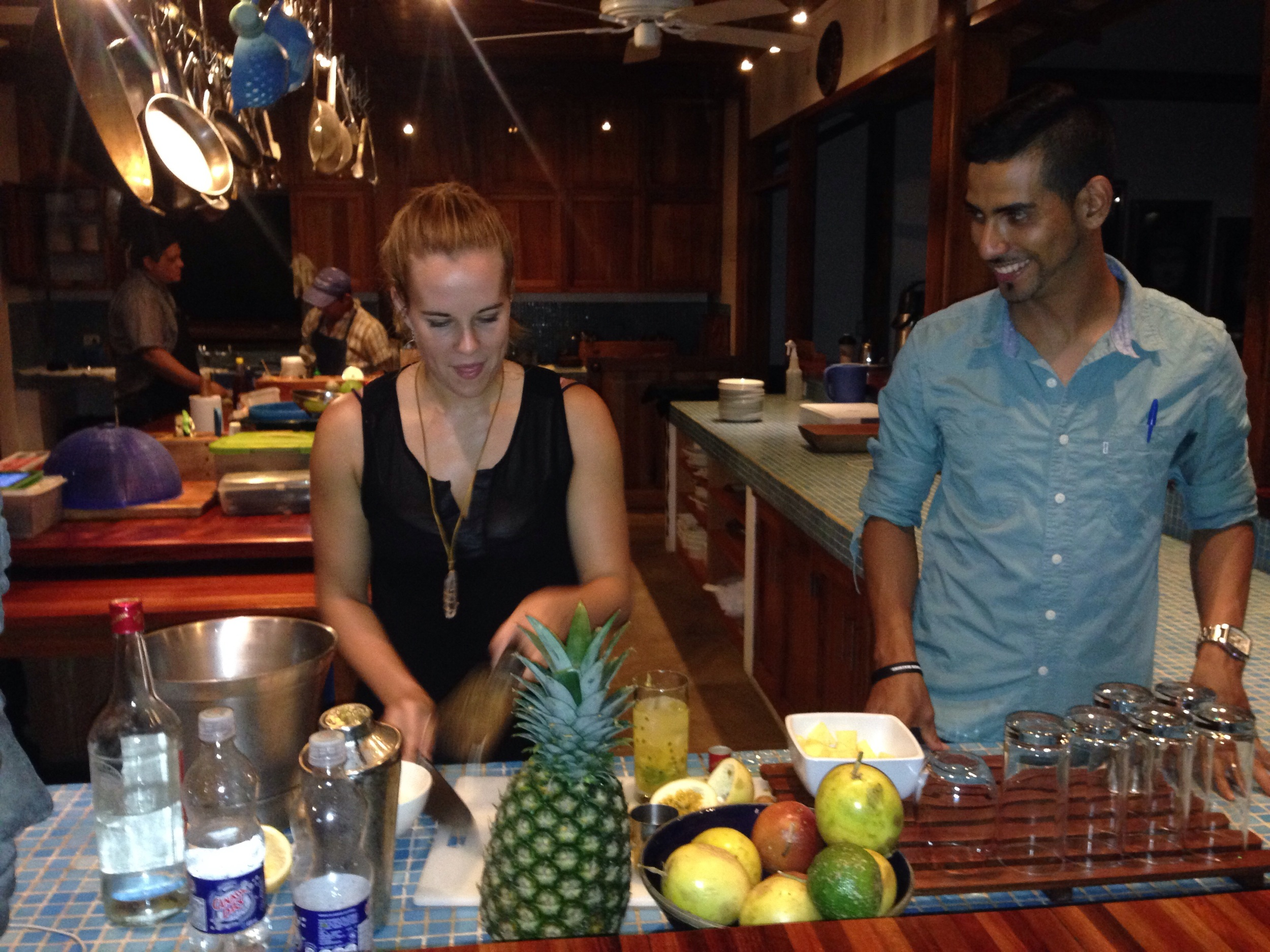 """That's Casey from """"A Cruising Couple"""". Our work here happened to coincide and we all quickly bonded (as all travel bloggers should, I'm sure!). This is Casey having fun as a guest bartender at cocktail hour before dinner. She makes 'em strong."""