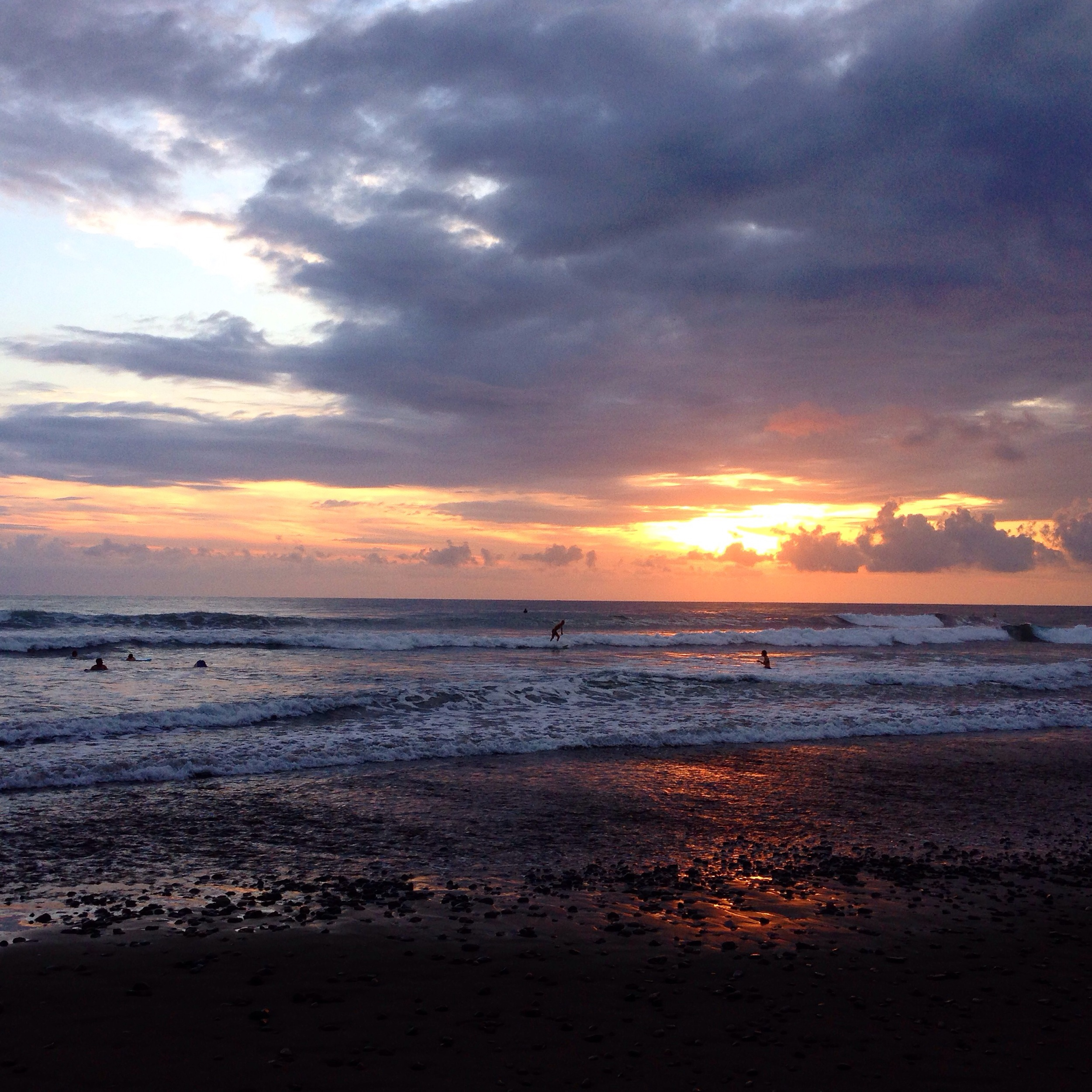 Watching surfers race out at sunset is one of my favorite past times.