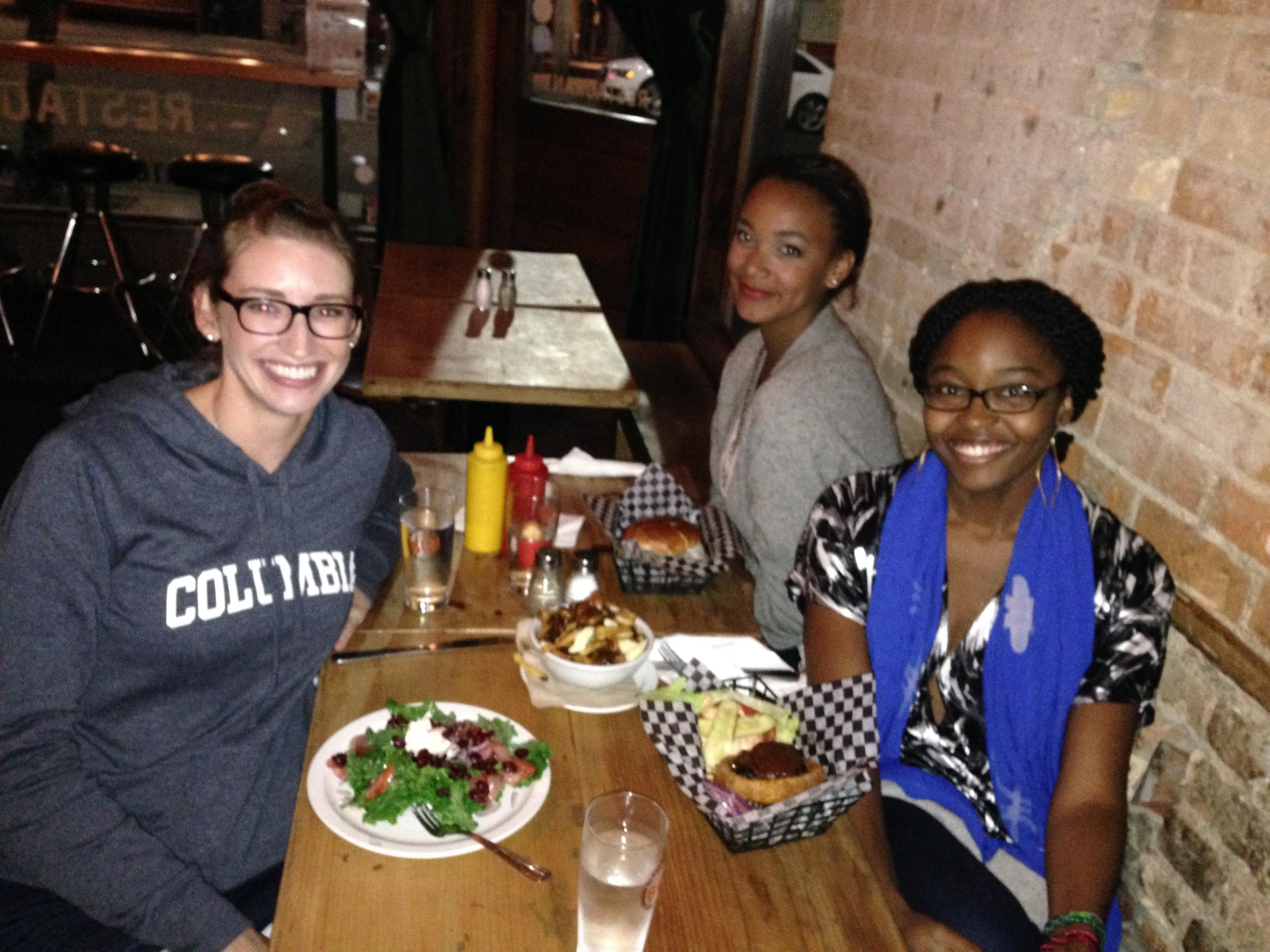 Friends enjoying a meal at BQM.
