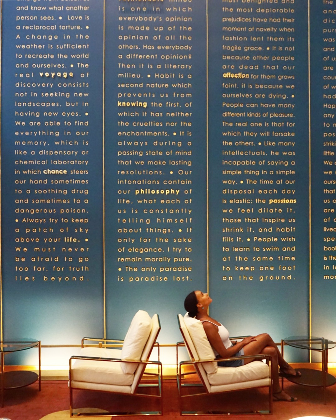 Diverse female traveler in luxury hotel lobby