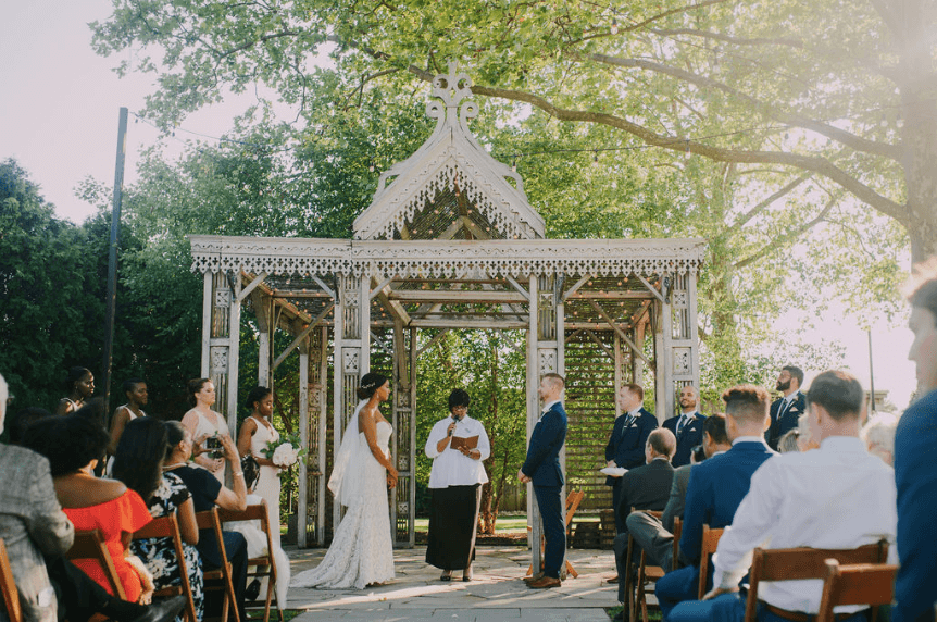 Wedding ceremony at Terrain at Styers with boho chic decor and handcrafted temple. Photo credit: Alex Medvick Photography