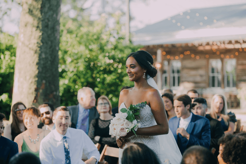 Bride walking down the aisle with boho dress Photo credit: Alex Medvick Photography
