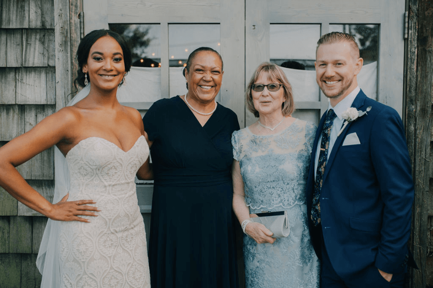 Bride and groom, plus both mothers - wedding photo Photo credit: Alex Medvick Photography