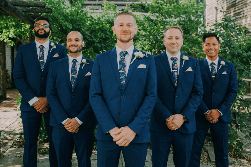 Groomsmen: blue suits, floral tie, pink pocket square Photo credit: Alex Medvick Photography