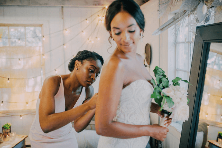 Maid of honor and bride at Terrain wedding Photo credit: Alex Medvick Photography