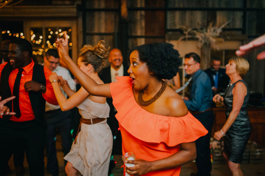 Guest dancing at wedding reception - Terrain at Styers Photo credit: Alex Medvick Photography