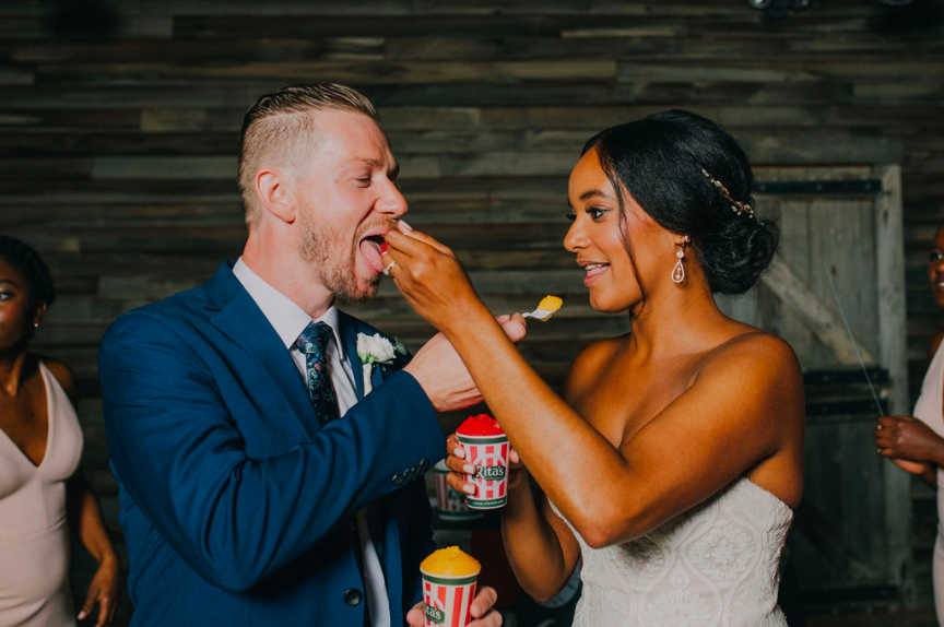 Bride and groom exchanging scoops of Rita's Water Ice during Terrain wedding Photo credit: Alex Medvick Photography