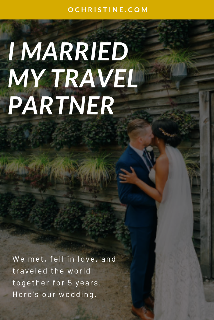 Interracial wedding / interracial couple / Black boho bride kissing groom in front of living wall at Terrain at Styers wedding.