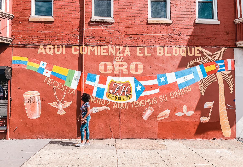 Standing in front of el bloque de oro mural in North Philadelphia