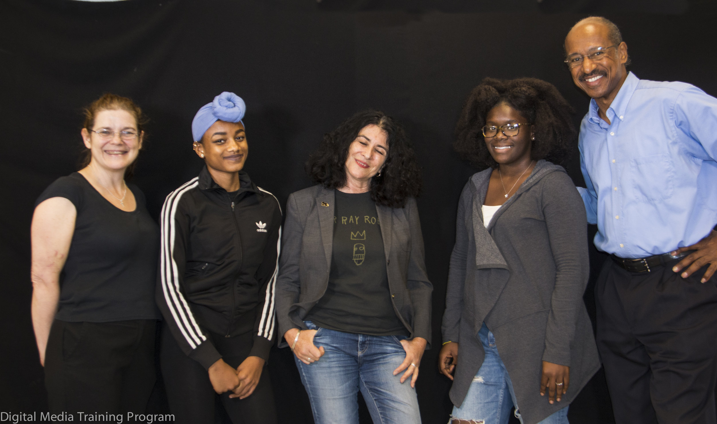 J  ournalism Instructors Joann Mariani and Melvin McCray (far left and far right) assist New Explorers High School students at the conclusion of an interivew with Photographer Janette Beckman (center).