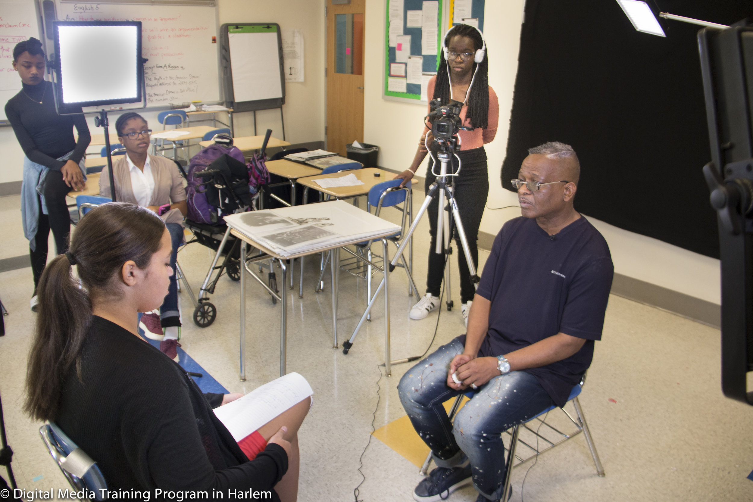 Artist Guy Woodard being interviewed at New Explorers High School