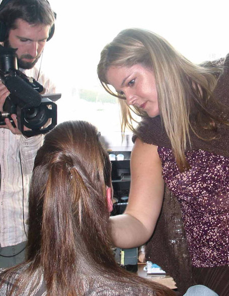 Media personality Christine Tizzard gets prepped in cramped quarters with film crew at the Juno Awards.