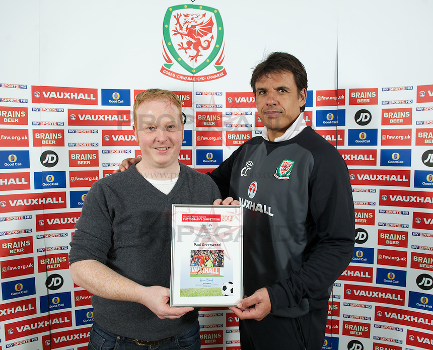 Paul recieves his Vauxhall Wales Photograph of the Year from Wales manager Chris Coleman.