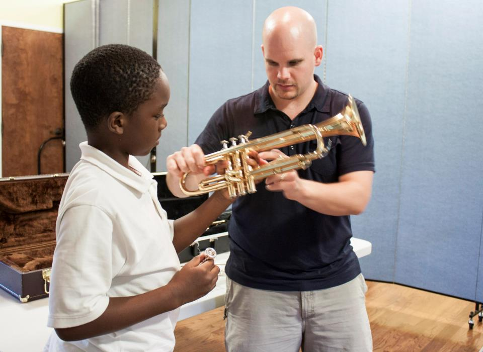 Teaching a beginner at the Atlanta Music Project.
