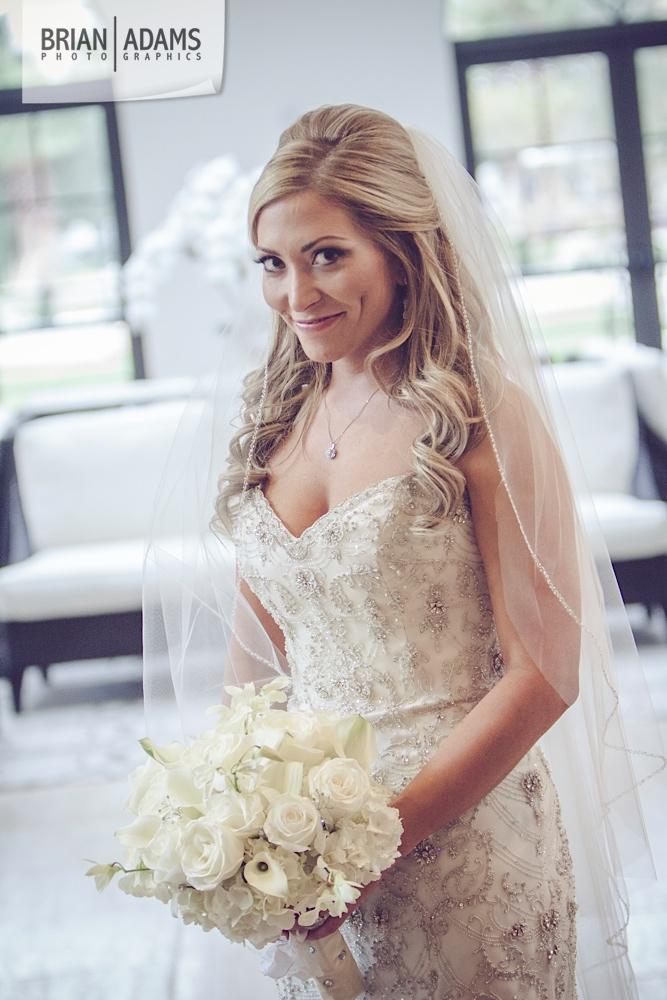 Bride, Smile, Bouquet, White Flowers, Wedding Dress by Orlando Florida wedding photographer Brian Adams PhotoGraphics,  brianadamsphoto.com