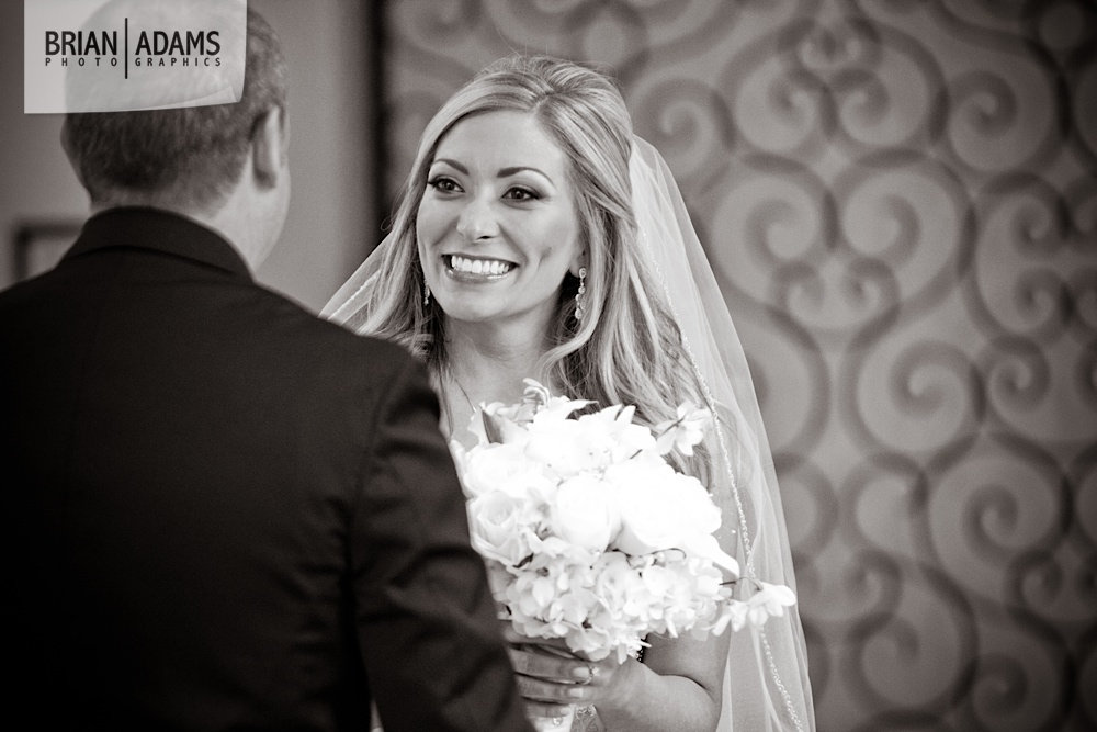 Wedding day first look with smiling bride and white wedding flowers at the Alfond Inn photo by Orlando Florida wedding photographer Brian Adams PhotoGraphics,  brianadamsphoto.com