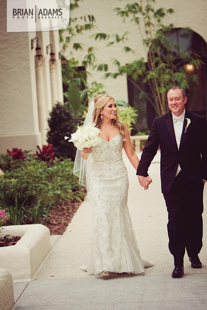 Bride and groom first look, beaded wedding dress, white bridal flowers, at the Alfond Inn photo by Orlando Florida wedding photographer Brian Adams PhotoGraphics,  brianadamsphoto.com