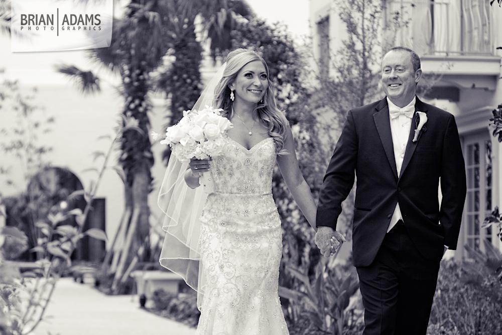 Bride and groom first look at the Alfond Inn, beaded wedding dress, white bridal flowers, photo by Orlando Florida wedding photographer Brian Adams PhotoGraphics,  brianadamsphoto.com