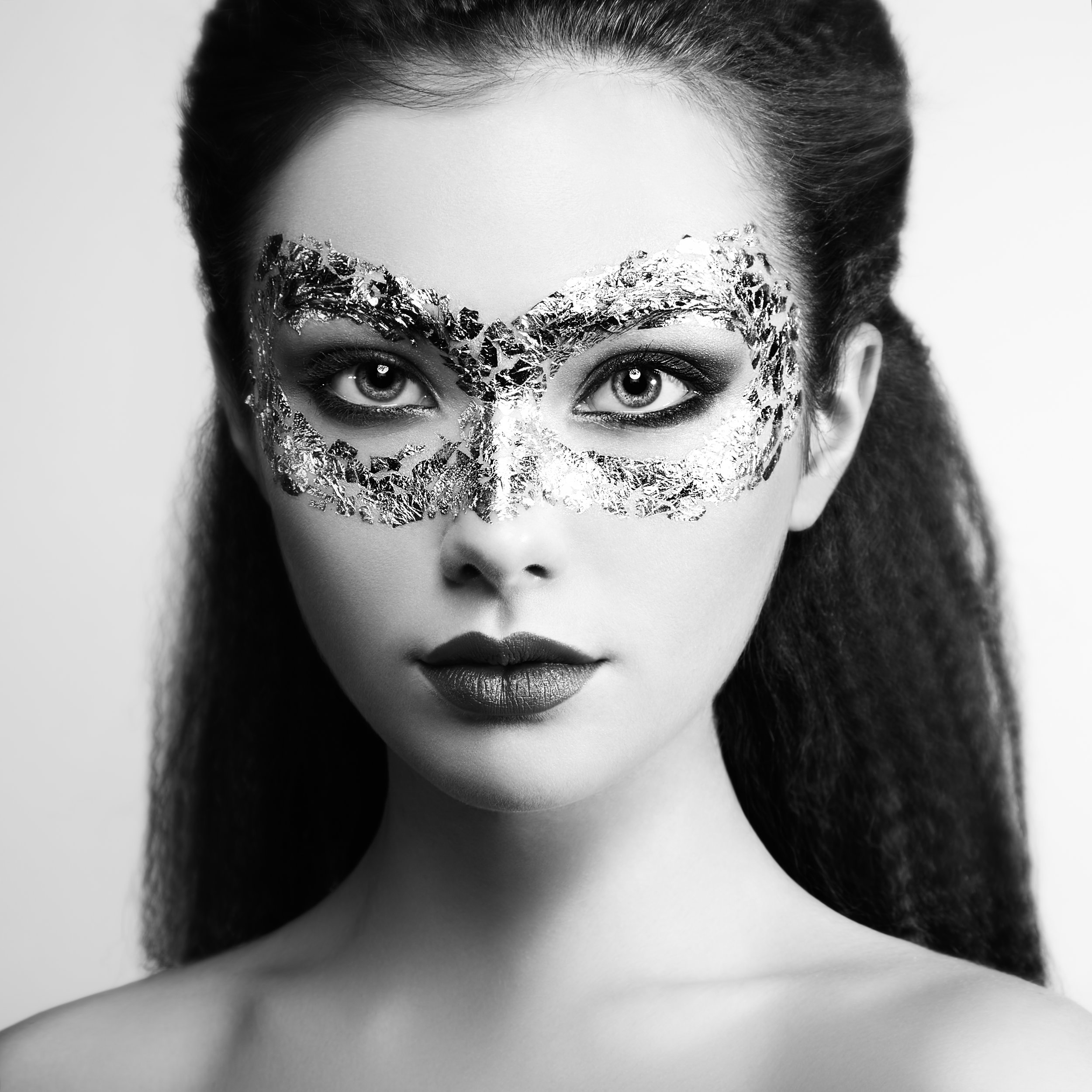 beautiful-young-woman-in-gold-mysterious-mask-PDEYZKQ.jpg