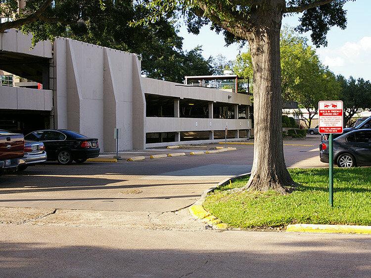 Turn right into parking lot from Wild Indigo Street.
