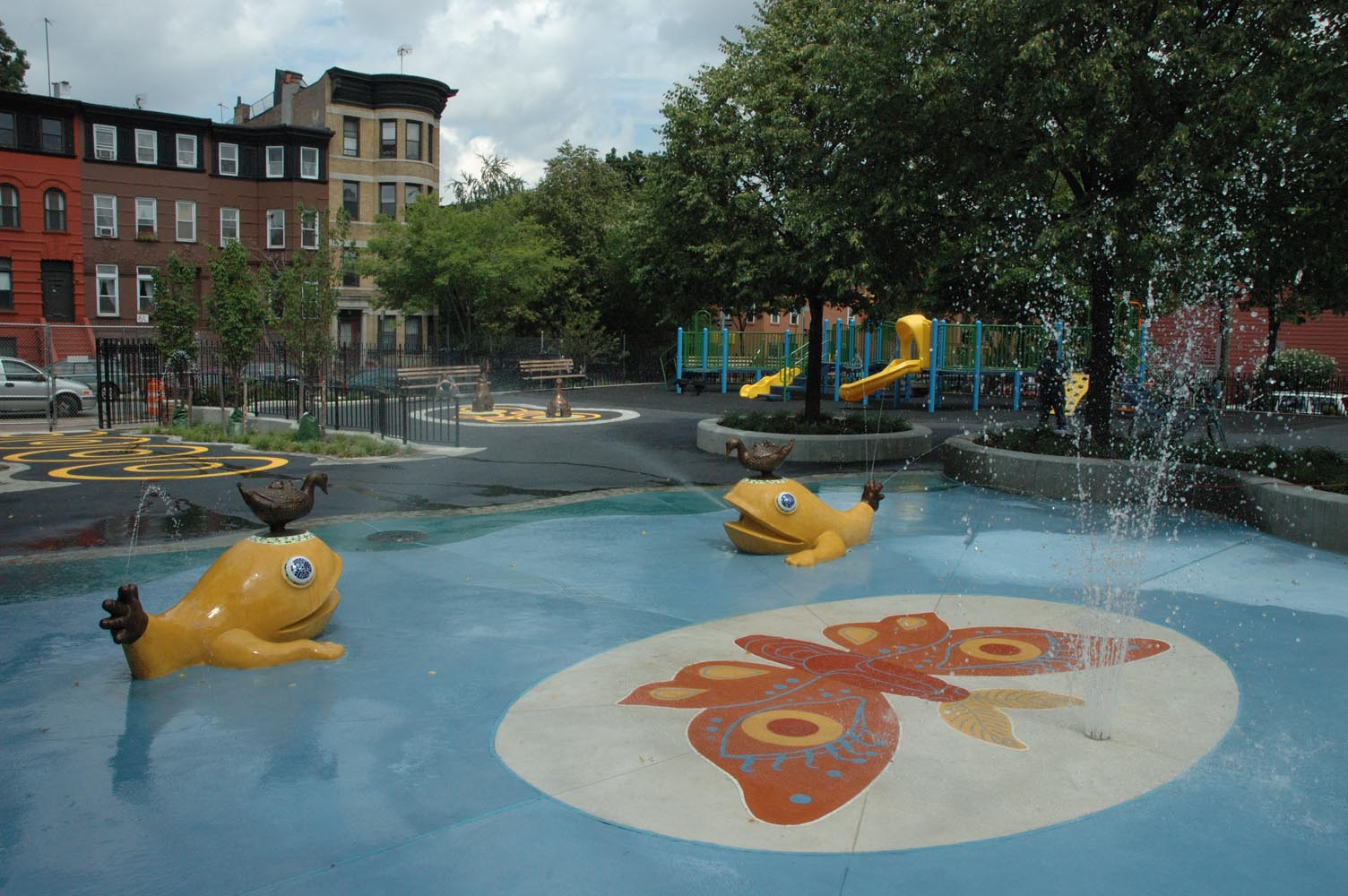 View of  Underhill Playground  from the back. In this view I designed the art for the poured, colored concrete  Moth Motif , two  Aqua-Monster Fountains ,  and two bronze sculptures.