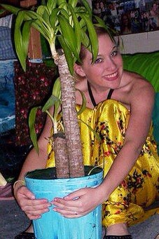 Junior year of college. My best friend/roommate and I had matching yucca plants. We gave them Korean names because I always wanted to adopt from South Korea. This is Joo-Chan.  This is also when I had collarbones.