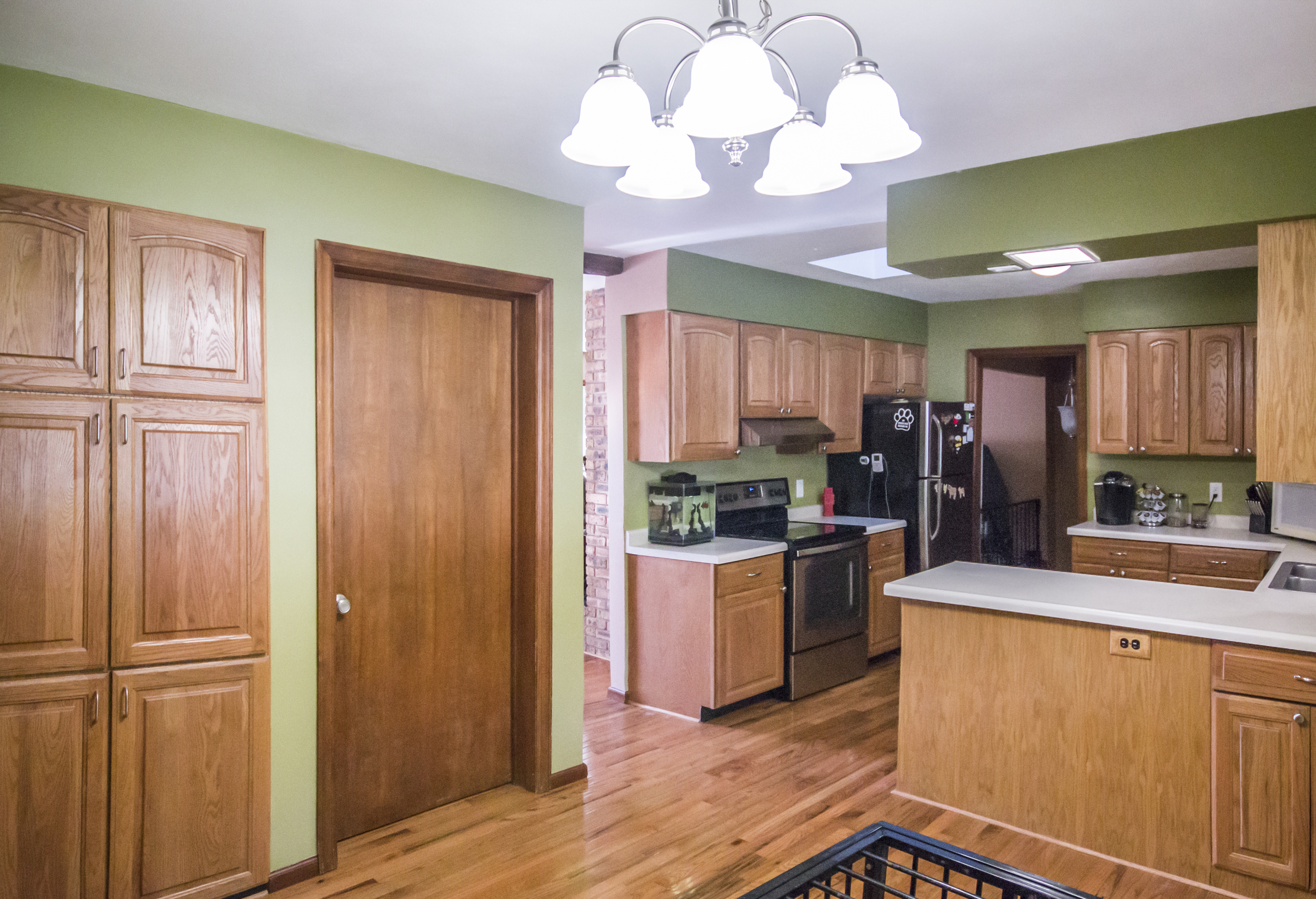 Changed: Green paint (darker green above cabinets), new lighting fixture, new knob for laundry room door.