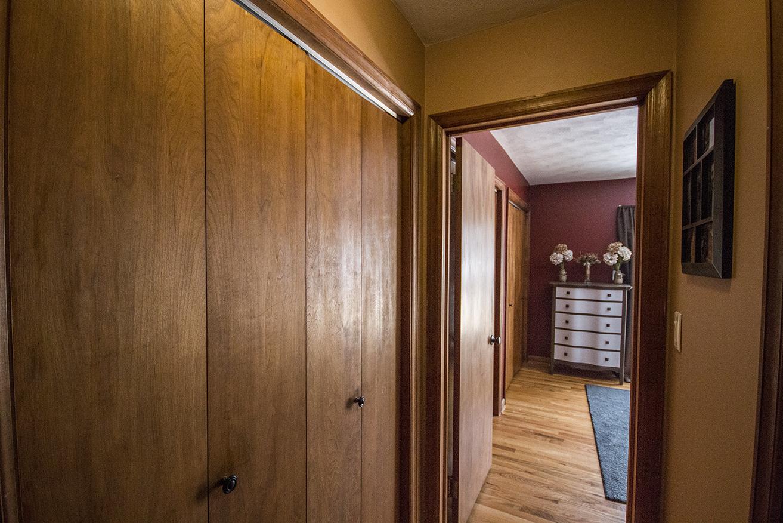 Changed: Brown paint, door knob, wall art.