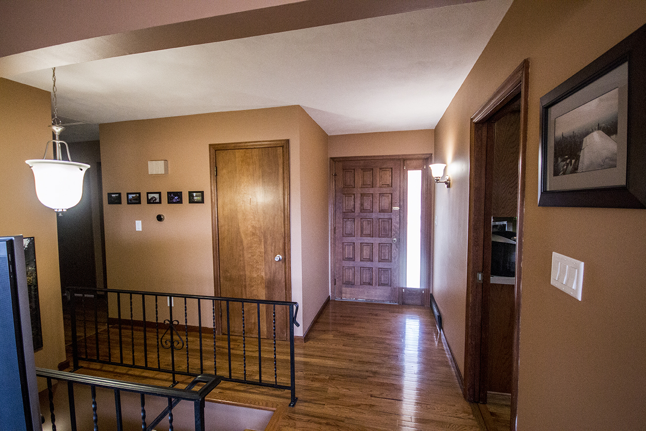 Changed: Light brown wall color, entry way light updated to match style of light above stairs, artwork on walls, removed curtain from front door window and put on a layer of spray-on frost, changed doorknob of coat closet, new light switch panels, installed Nest thermostat, removed rug.