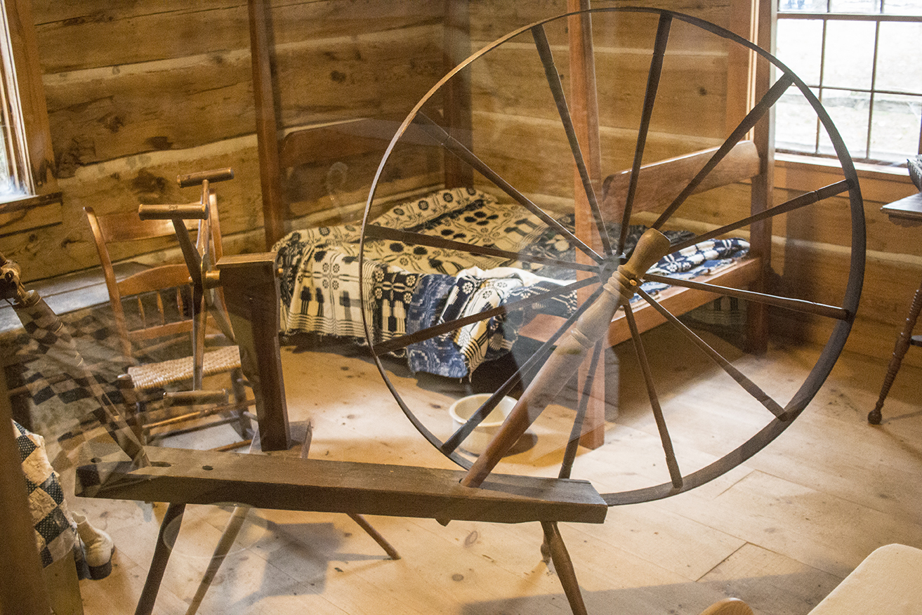 The cabin's display featured an old spinning wheel and a swift!
