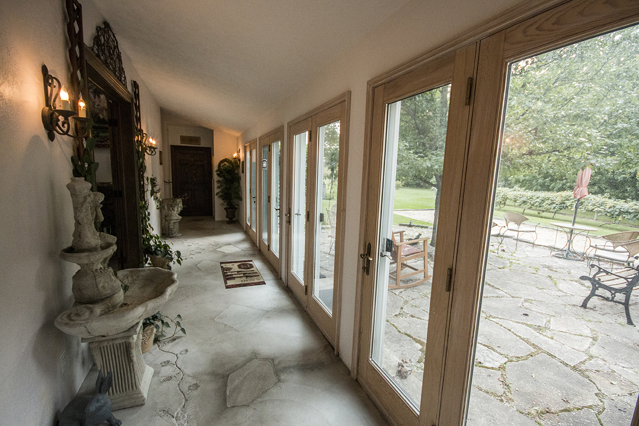 The hallway and exterior seating.