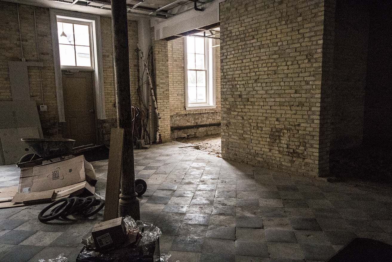 The kitchen for the Asylum, which is awaiting renovation as soon as someone wants to use the area for a restaurant. The tiles are worn from walking; they plan to keep as much of the original floor as possible when it is renovated.