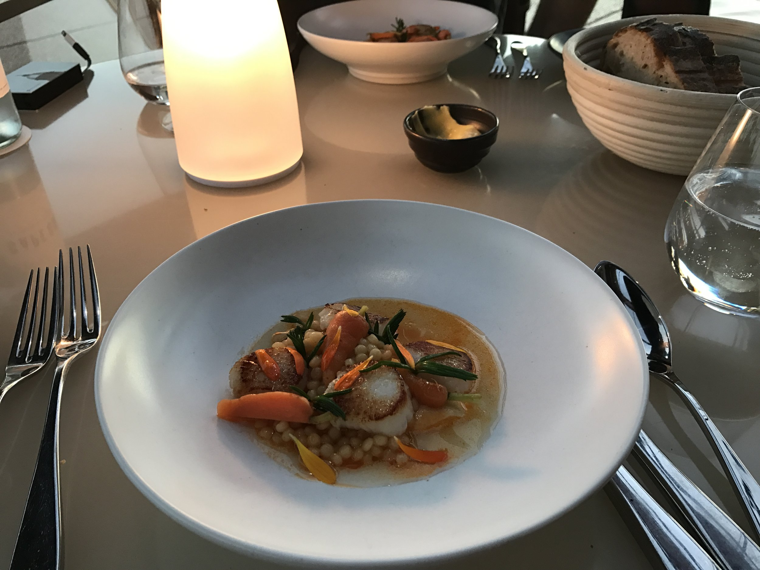 Hervey Bay scallops with Israeli couscous, young carrots, prawn custard, and chili oil.