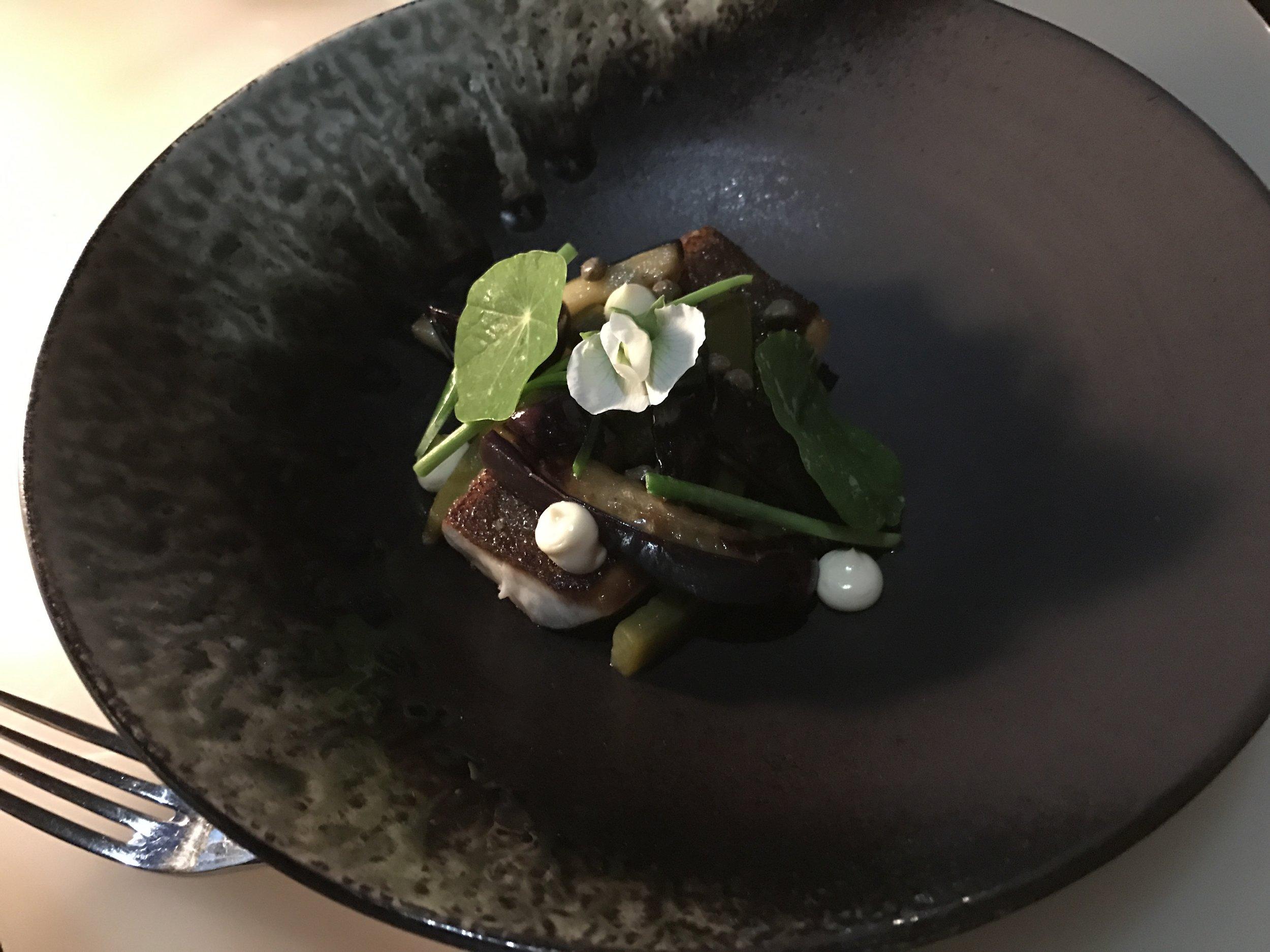 Roasted black kingfish, green capsicum, eggplant caponata, capers, and olives.