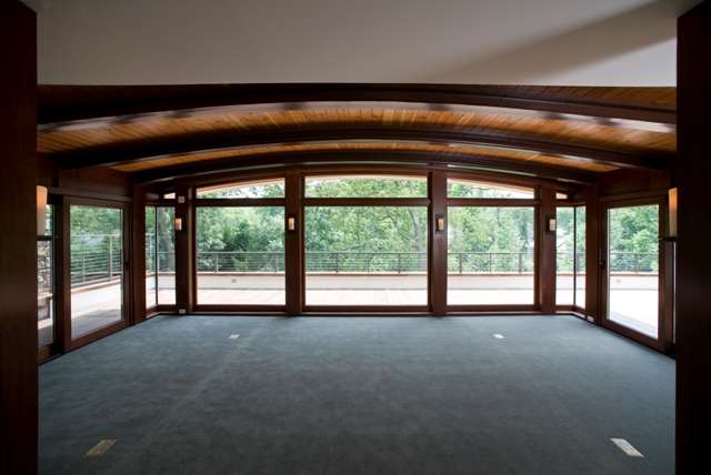 Custom Arched Windows and Sliding Doors