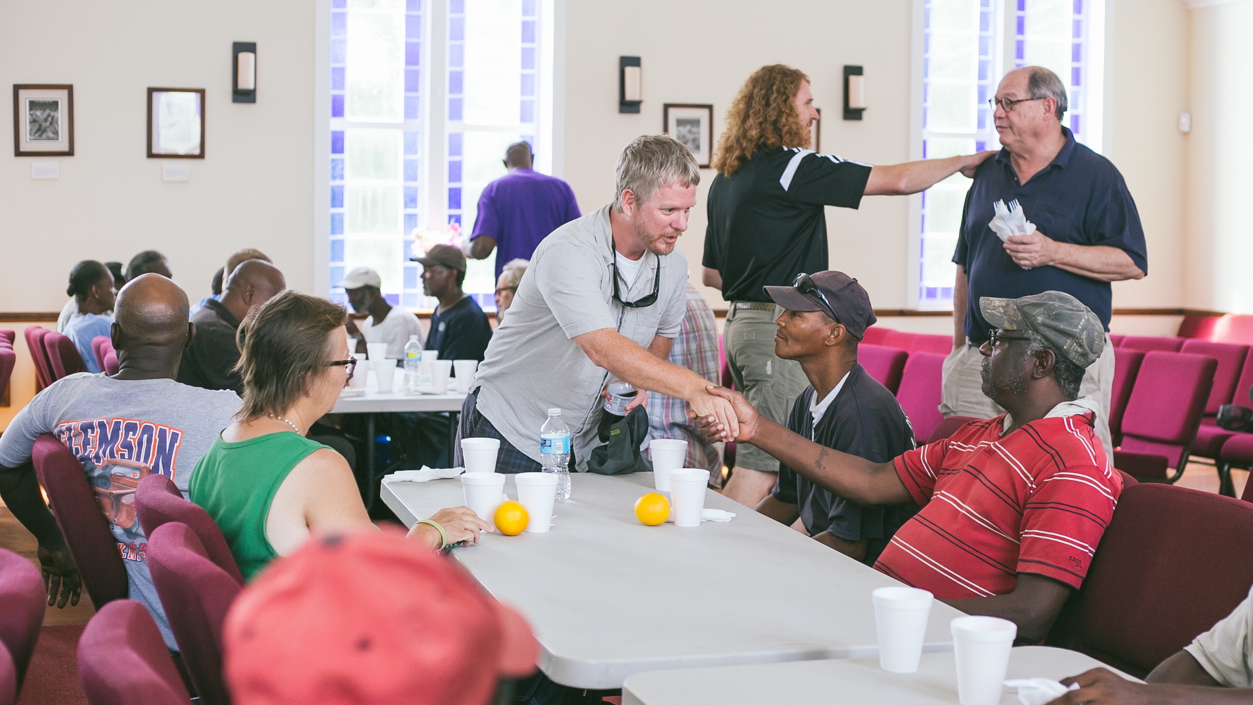 Members serving and connecting during our monthly brunch ministry at St. John's Chapel. Photos by Anna Warner, 2015