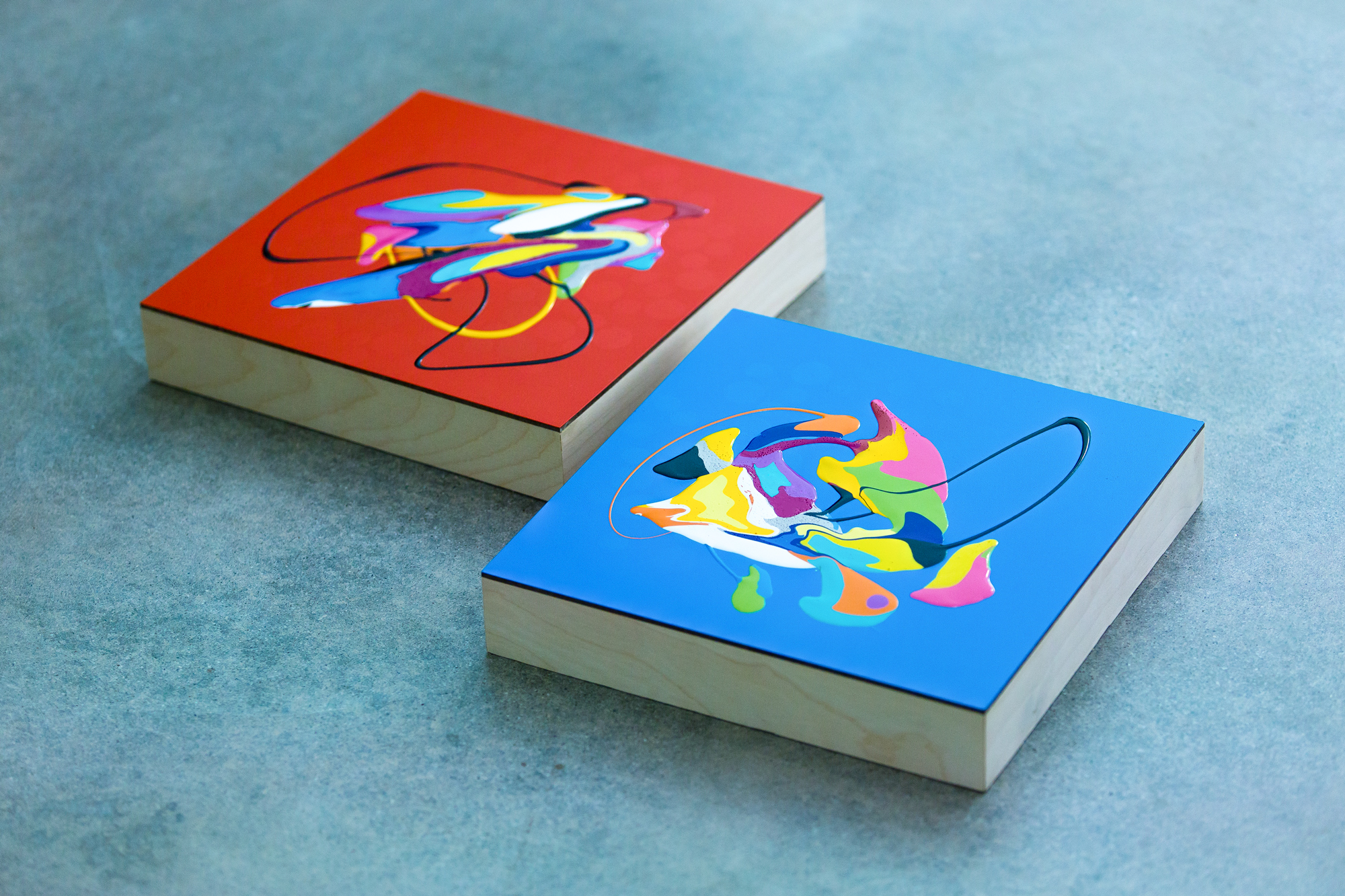 Untitled (splat series #22 and #23), 2015 Oil base enamel and spray paint on wood 10 x 10 x 2.5 inches (each)