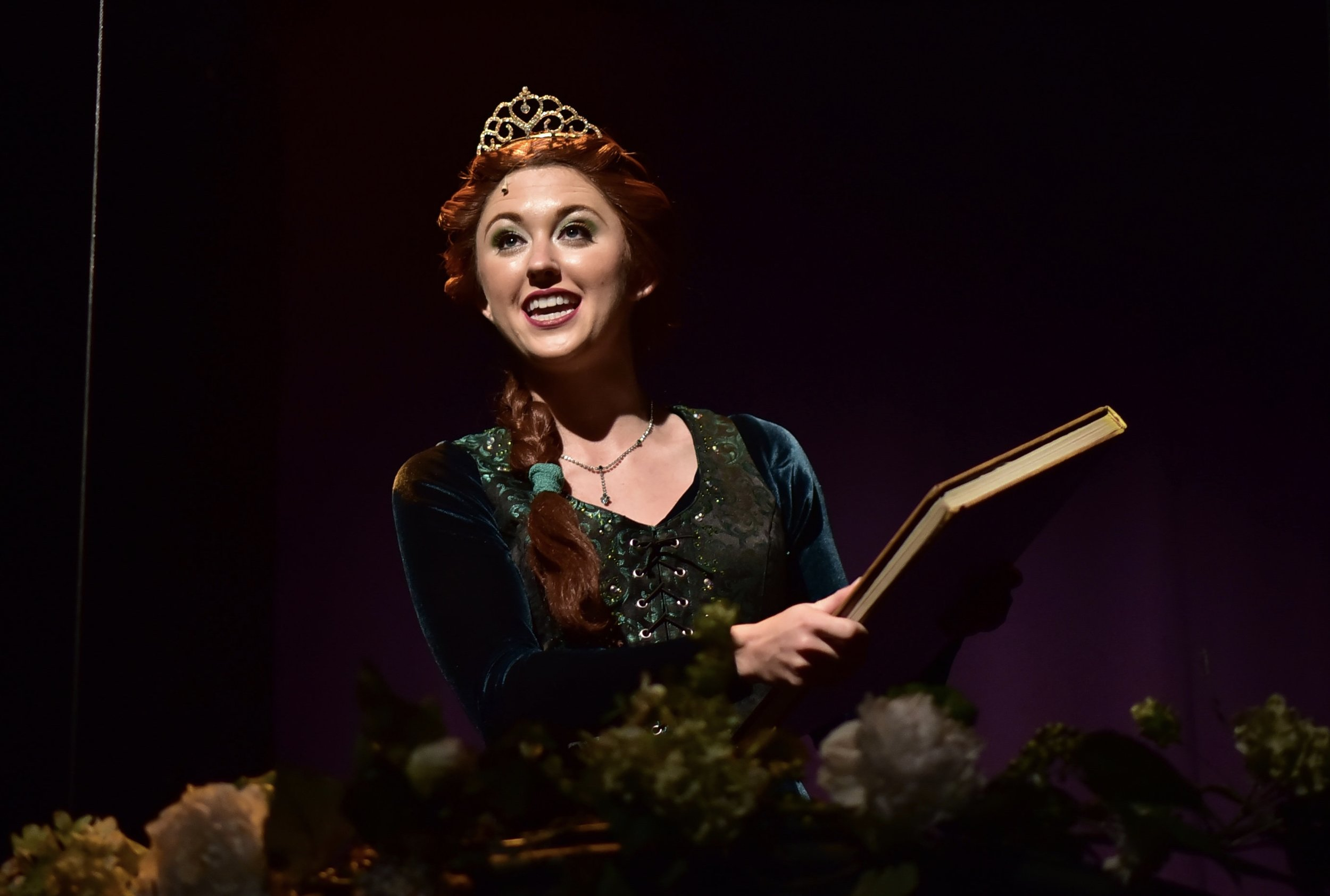 """The Herald Bulletin - """"You won't find a one-dimensional damsel in distress in Emily Grace Tucker's role as Princess Fiona. She's a fiery female who values tradition, but has her own complexities that lead her down another path. She holds her own alongside the boys, and her singing stands out""""."""