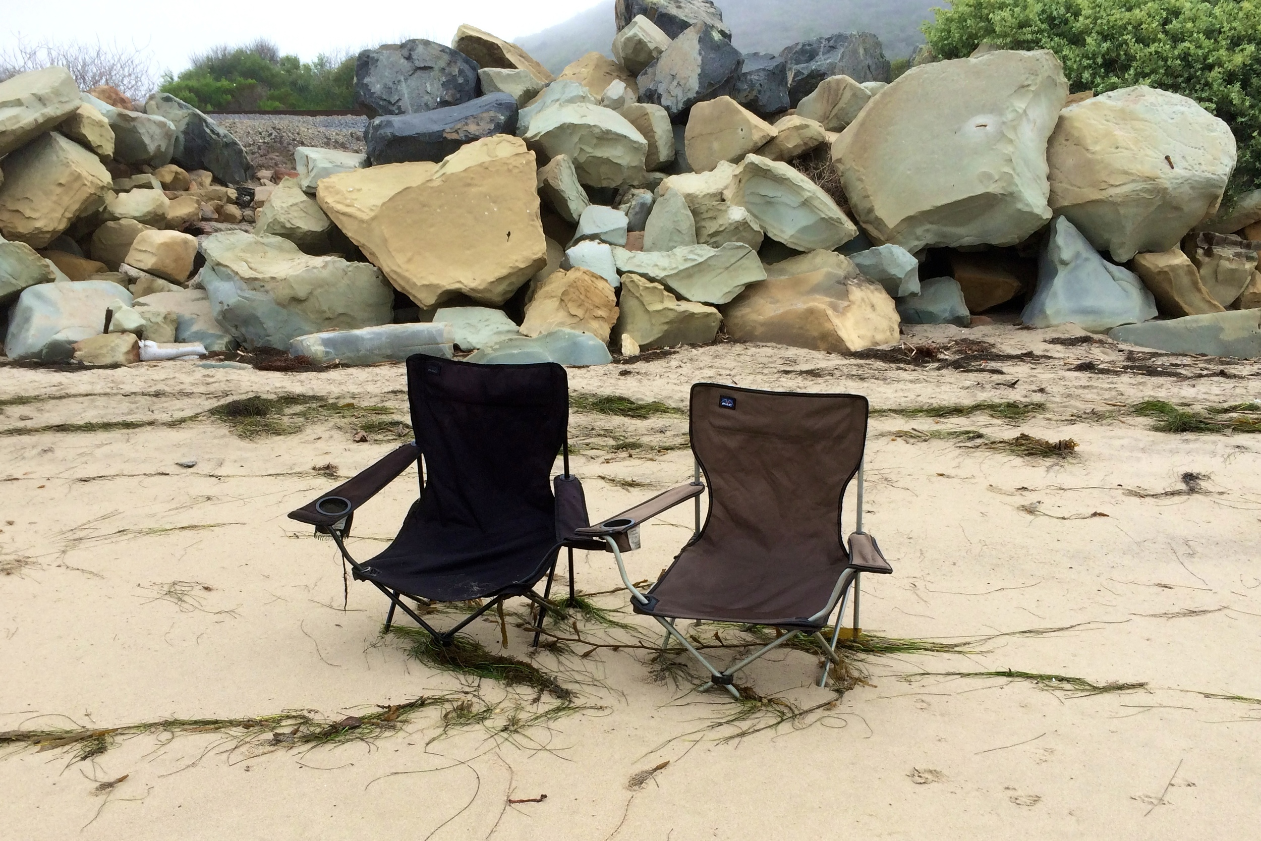These chairs have obviously been here for a while. They are anchored in about a foot of sand. So wistfully abandoned.