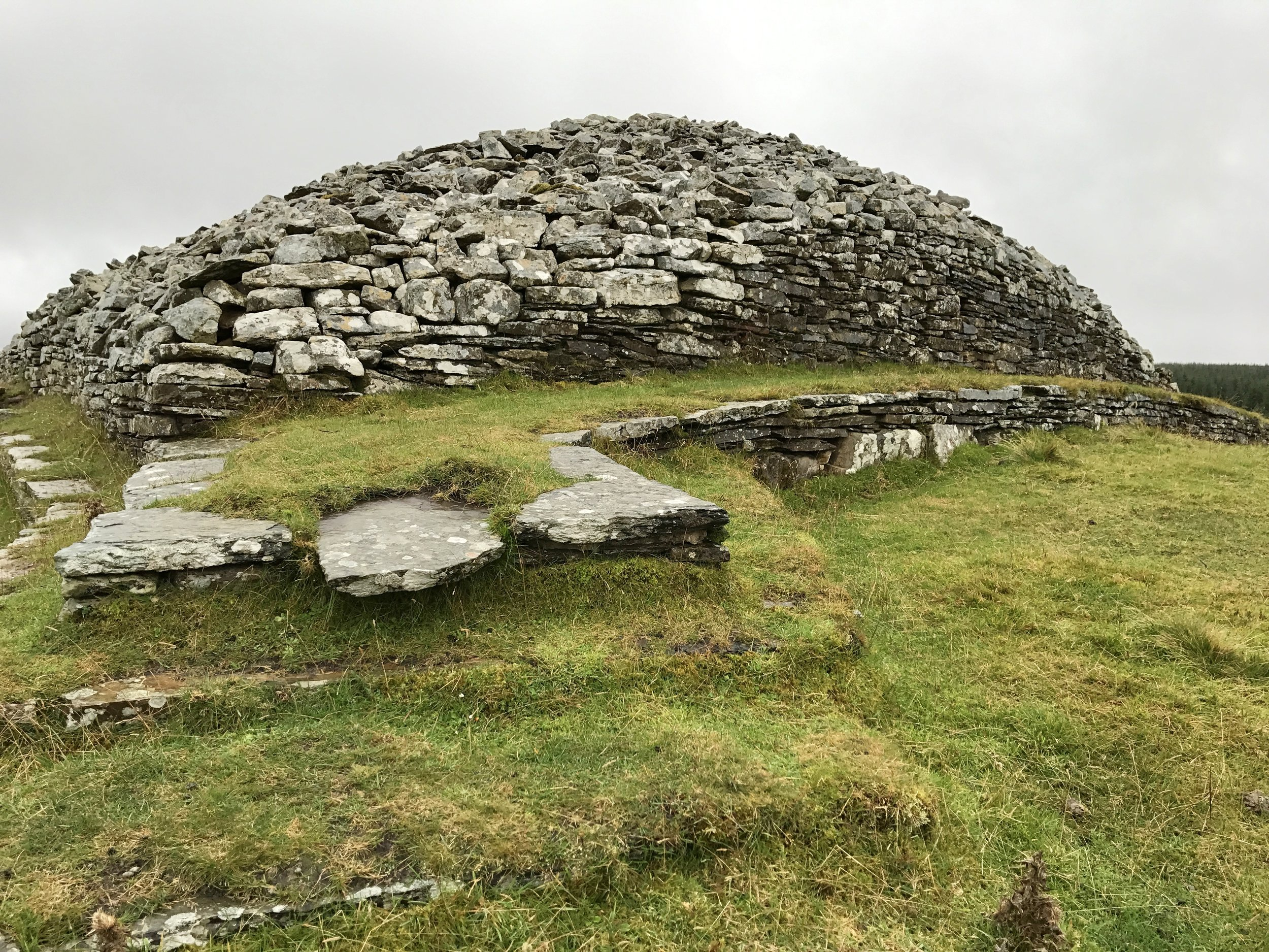 Outside a Neolithic cairn. In particular, the Grey Cairns of Camster outside of Wick.