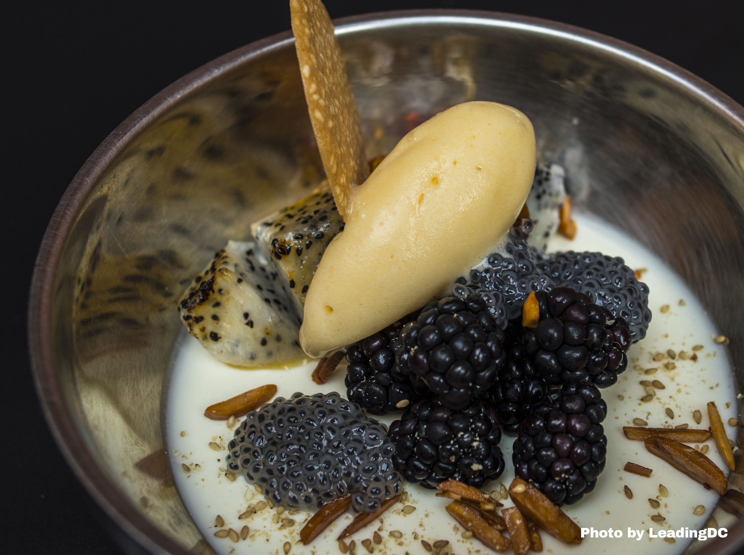 Sesame custard with lemongrass infused basil seeds and candied almonds
