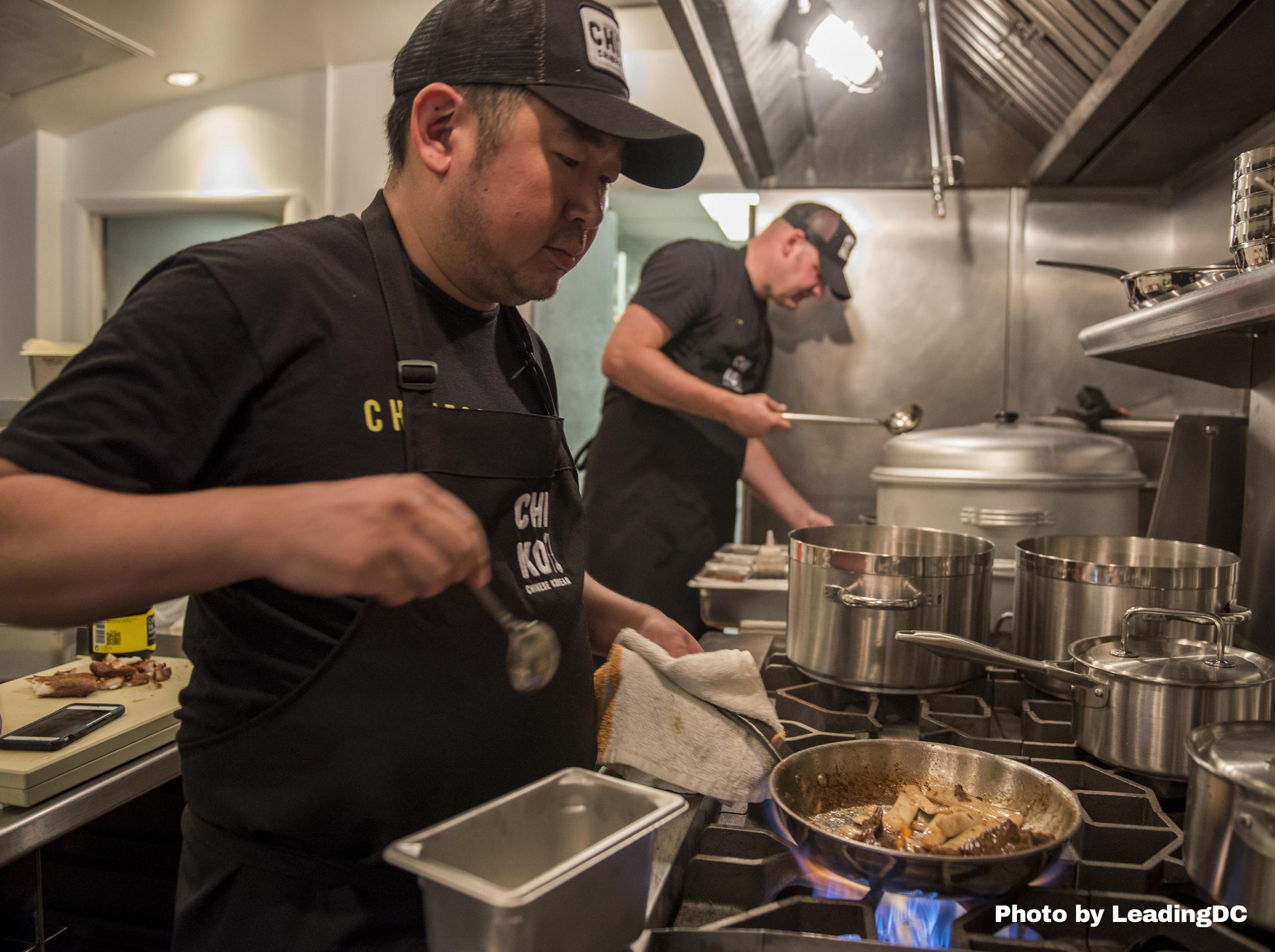 Chefs Danny Lee, left, and Scott Drewno in the kitchen